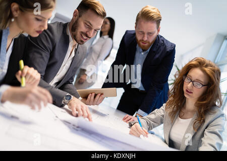 Group of architects working on business meeting - Stock Photo