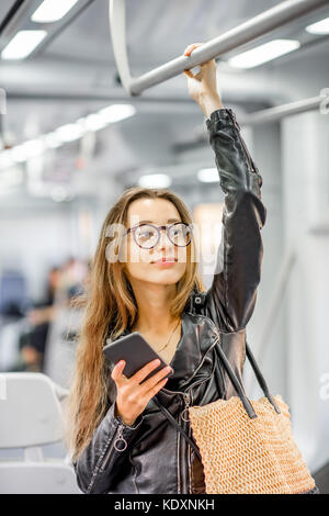 Woman riding at the modern train - Stock Photo