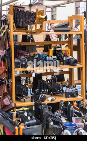 Old vintage cameras on display at a stall at Portobello Road Market in Notting Hill, London, Uk - Stock Photo