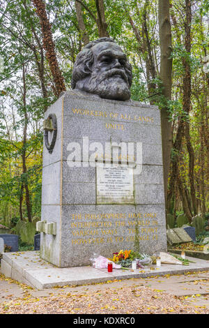 Karl Marx grave in the eastern part of Highgate cemetery featuring a gigantic bust of the revolutionary socialist, - Stock Photo