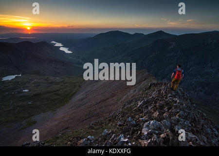 mountaineer walking on ridge above Llanberis north wales, - Stock Photo