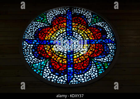 Colourful stained glass window in modern church, Diakonikon Baptistry Chapel, housing remains Byzantine Church and - Stock Photo