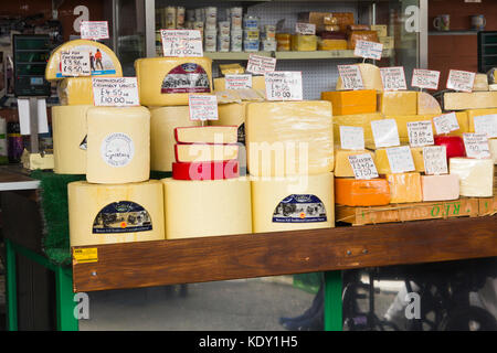 Purdons cheese stall on Bury market. The stall sells a wide range of traditional English cheese specialising in - Stock Photo