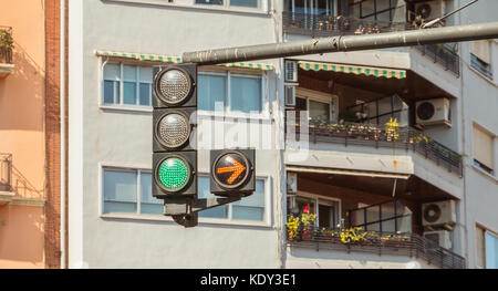 VALENCIA, SPAIN - June 18, 2017 : traffic light green with yellow arrow on right - Stock Photo