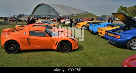 Rows of sports (lotus) cars lined up looking towards the American hanger at car show IWM Duxford England. - Stock Photo