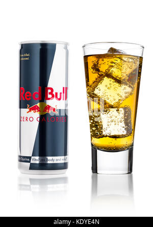 LONDON, UK - APRIL 12, 2017: Can of Red Bull Energy Drink Zero Calories with glass and ice cubes on white background - Stock Photo