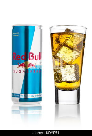 LONDON, UK - APRIL 12, 2017: Can of Red Bull Energy Drink Sugar Free with glass and ice cubes on white background - Stock Photo