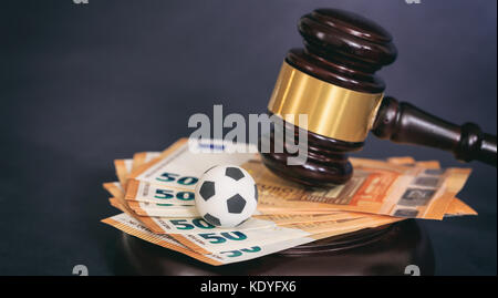 Judge gavel, football soccer ball and euro banknotes on black background - Stock Photo