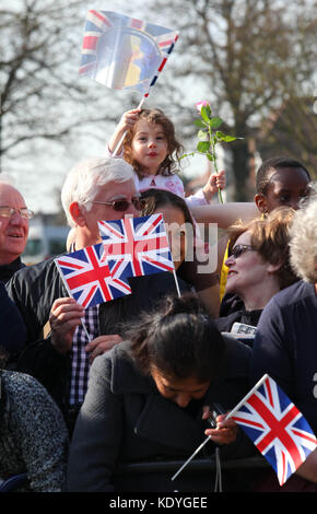 LONDON, ENGLAND - MARCH 29: Crowds cheer as Queen Elizabeth II arrives in Valentine's Park Redbridge as part of - Stock Photo