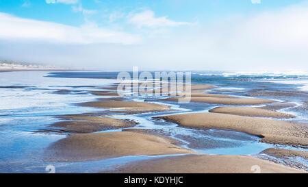 Patterns in sand, low tide, Nehalem Bay, Nehalem Bay State Park, Oregon.  Between the Pacific Ocean and Nehalem - Stock Photo