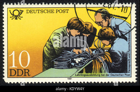 A postage stamp printed in DDR shows apprenticeship training, Postal History of Germany, circa 1981