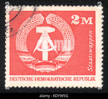 A postage stamp printed in DDR shows Emblem of the DDR, circa 1975