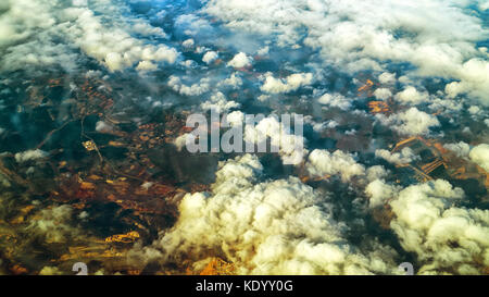 Aerial view of curly sunny clouds and their shadows on mosaic earth landscape of Gran Canaria island, Spain from - Stock Photo