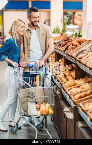 couple in grocery shop - Stock Photo