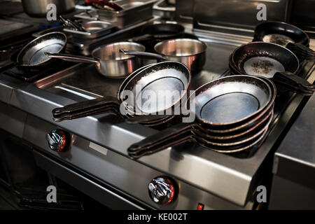 Metal black pans on restaurant kitchen - Stock Photo