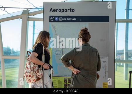 Tourists looking at the metro map, Aeroporto Francisco Sa Carneiro or Francisco Sa Carneiro Airport, Porto, Porttugal - Stock Photo