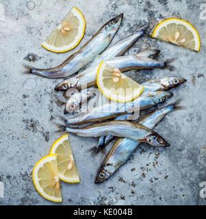 Fresh catch Shishamo fish fully eggs flat lay on shabby metal background. Shishamo fish is popular fish for Japanese - Stock Photo