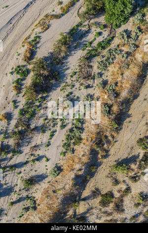 Lines of desert sand and growth in a view from the sky above. - Stock Photo