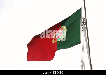 Backwards facing Portuguese Flag fluttering in the wind on a flagpole at Fortaleza do Pico in Funchal, Madeira - Stock Photo