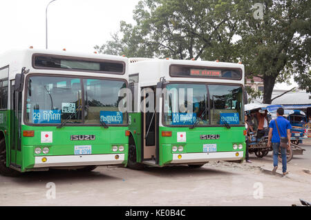 Green city buses donated by Japanese government at Central Bus Station located next to the Morning Market or Talat - Stock Photo