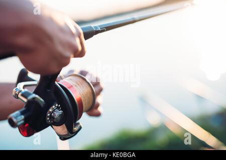 Fishing, hobby and recreational concept - fishermen - Stock Photo