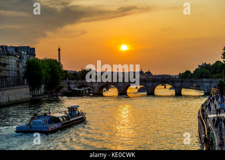 Sunset over the Seine River in Paris - Stock Photo