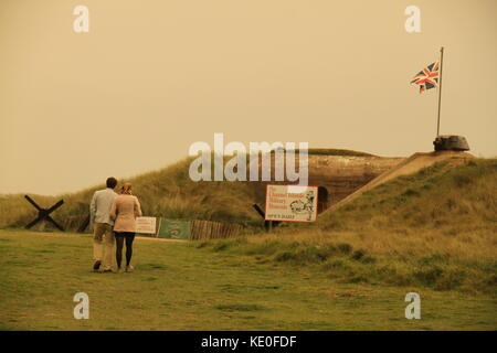 Jersey, UK. 16th Oct, 2017. A couple walk towards the Channel islands war museum in the west of the island in hazy - Stock Photo