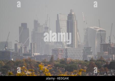 London, UK. 17th Oct, 2017. UK Weather. London city financial skyline seen from Wimbledon basks in morning hazy - Stock Photo