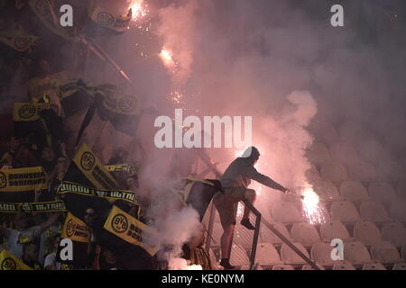 Nicosia, Cyprus. 17th Oct, 2017. Dortmund fans light fireworks in the stands during the Champions League group stages - Stock Photo