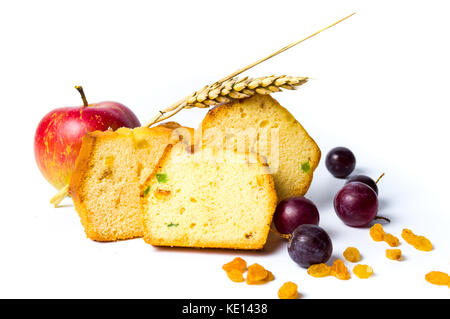 Homemade fruit bread with raisins, grape and apple on white - Stock Photo