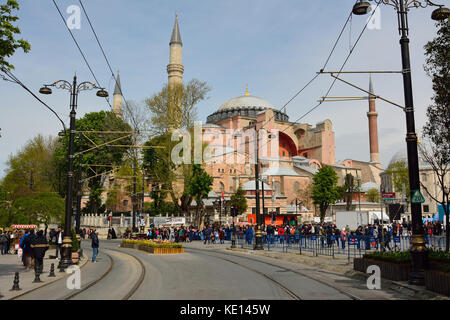 Istanbul, Turkey - April 22, 2017. Street view in Sultanahmet district of Istanbul, with Aya Sofya mosque and people. - Stock Photo