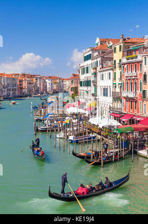 VENICE ITALY VENICE Gondolier rowing a gondola full of tourists on a gondola ride on the grand canal Venice Italy - Stock Photo