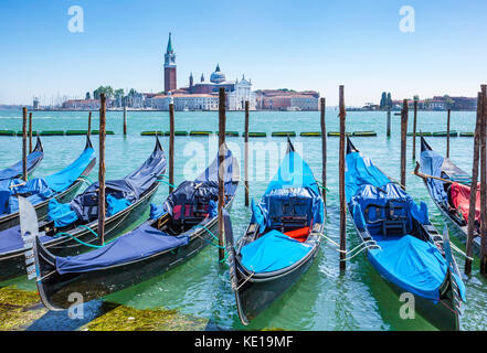 Italy venice italy moored gondolas on the Grand Canal Venice opposite the Island of San Giorgio Maggiore Venice - Stock Photo