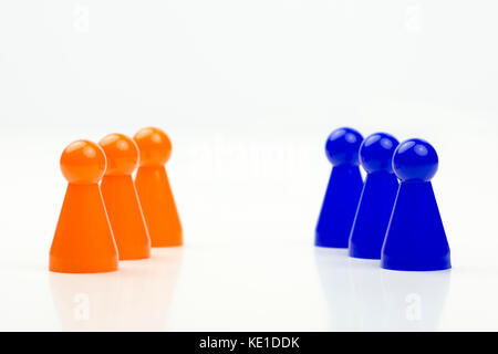 Close-up photo of a group of different-colored pieces in different positions on a white background - applicable - Stock Photo