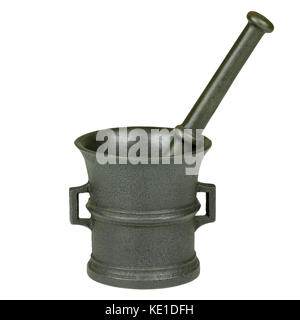 Close-up photo of a cast-iron mortar with a stick isolated on a white background - Stock Photo