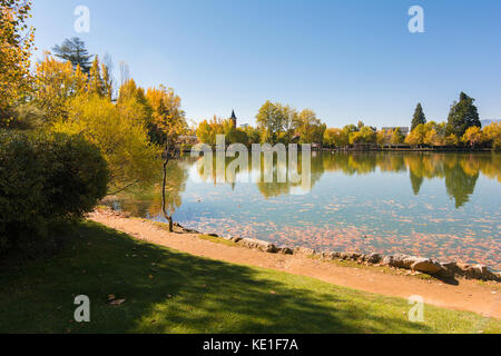 Autumn colors and reflection on the Puigcerda's pond water - Stock Photo