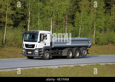 SALO, FINLAND - MAY 13, 2016: White MAN TGS 35.480 tipper truck moves along freeway in South of Finland. The TGS - Stock Photo