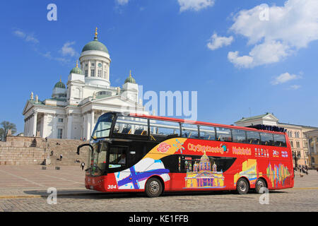HELSINKI, FINLAND - MAY 10, 2016: Red double-decker Hop On Hop Off sightseeing bus waits for passengers at the Senate - Stock Photo