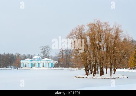 Grotto Pavilion on frozen pond in snowfall, early November winter. Catherine Park of Tsarskoye Selo, Pushkin, Saint - Stock Photo