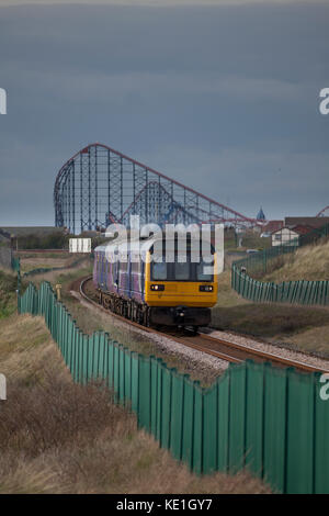 A Northern rail class 142 pacer train passes Squires Gate (Blackpool) with the 1721 Blackpool South - Colne - Stock Photo