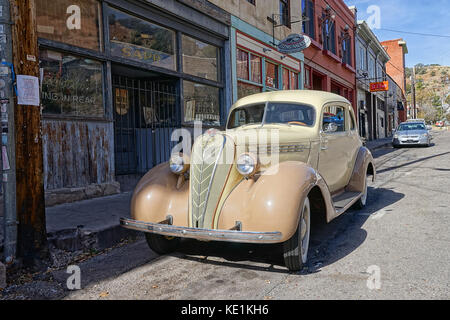 December 9, 2015 Bisbee, Arizona, USA: vintage collector's car parked in the front of victorian-style bulidings, - Stock Photo