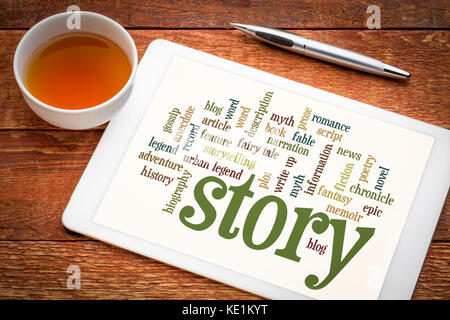 cloud of words or tags related to story, myth and legend on a  digital tablet with a cup of tea - Stock Photo