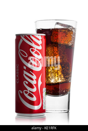 LONDON, UK - JUNE 9, 2017: Aluminium can with glass of Coca cola soft drink on white background.The Coca-Cola Company, - Stock Photo