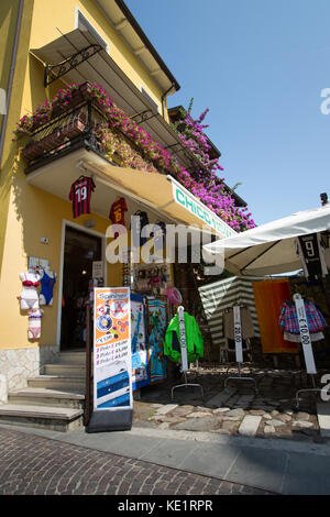Sirmione, Italy. Picturesque view of a shop on Via Dante, in the shadow of Scaliger Castle. - Stock Photo