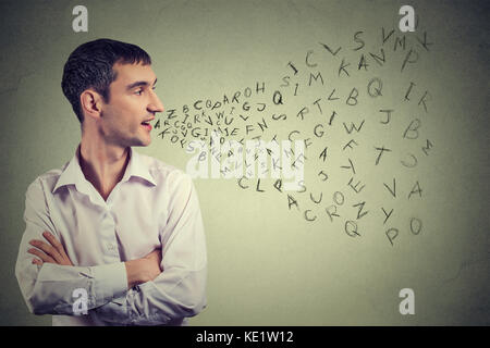 Side profile man talking with alphabet letters coming out of his mouth. Communication, information, intelligence - Stock Photo