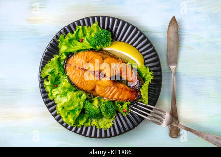 Grilled salmon steak with green lettuce and broccoli - Stock Photo