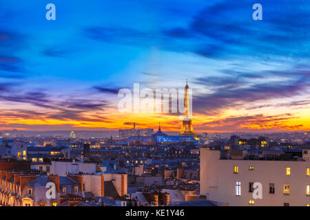 Shimmering Eiffel Tower at sunset in Paris, France - Stock Photo