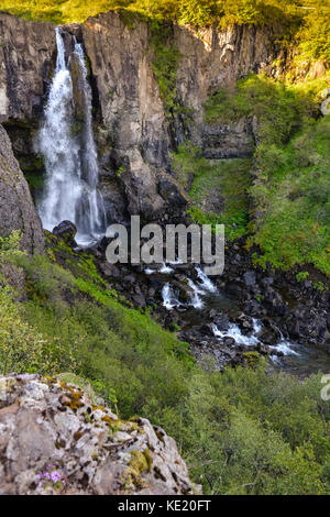 Hundafoss waterfall from above, Iceland in summer, water in motion blur. - Stock Photo