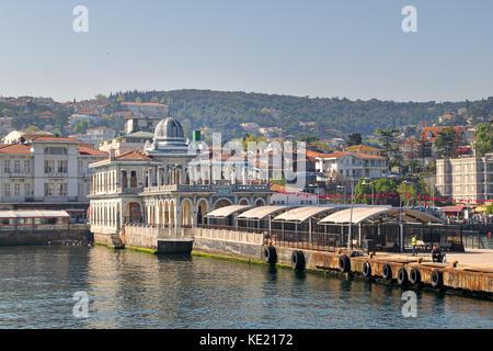 Istanbul, Turkey - April 27, 2017: Buyukada (Princess Island) Ferry Terminal with passengers riding a ferry and - Stock Photo