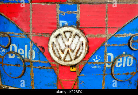 VW logo badge on colourful painted metal design - Stock Photo